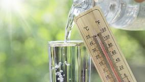 Glass of water with thermometer